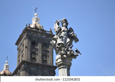 detail of the fountain in Puebla's zocalo with cathdral tower behind