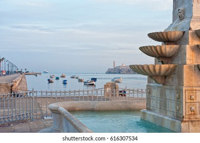 Detail of a fountain with view of havana bay in background
