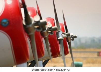 Detail of four aircraft propellers parked on platform