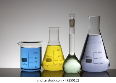 detail of four beakers with colored liquid