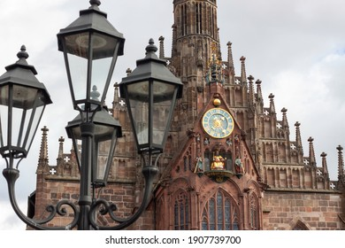 Detail of the Frauenkirche church facade in Hauptmarkt square with the construction date inscription in 1509 and a classical streetlight in the foreground