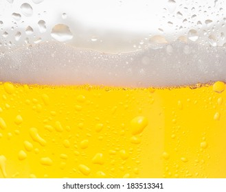 detail of fresh beer with drops for background