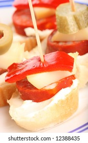 Detail of fresh snack with pepper, cheese and sausage