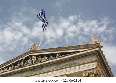 Detail of frieze of Academy of Athens and Greek flag.