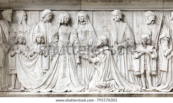Detail of the frieze on the exterior wall of the Supreme Supreme Court in Parliament Square, London. The carvings show Lady Jane Grey being offered the Crown of England by the Duke of Northumberland