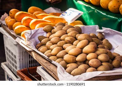 Detail of a fruit and vegetables street market in Bangkok, Thailand, with kiwi and other tropical fruit for sale