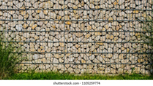 Detail of gabion wall filled with stones