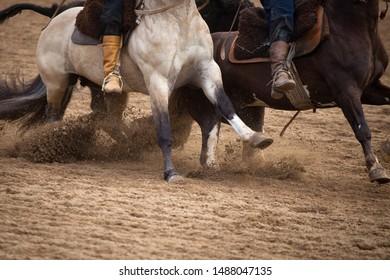 Detail of gauchos on horseback during rodeo