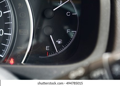 detail with the gauges on the dashboard of a car,fuel gauge