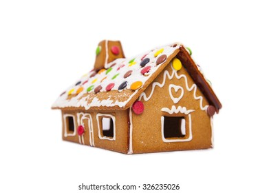 Detail of a gingerbread house decorated with sweets and icing.