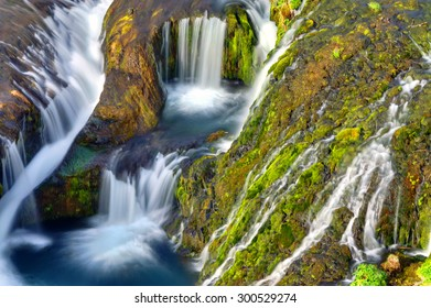 Detail of the Gjain valley with many small waterfalls in Iceland