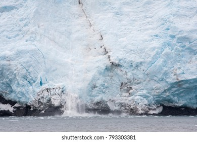 Detail of a glacier; blue of dense ice (melting and subliming ice) in Alaska, Aialik Glacier, which is a glacier in the Kenai Peninsula Borough of Alaska (Kenai Fjords National Park)