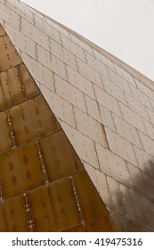 Detail of a gold aluminum facade showing fixings of the panels