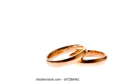 detail of gold wedding with space for text on white background