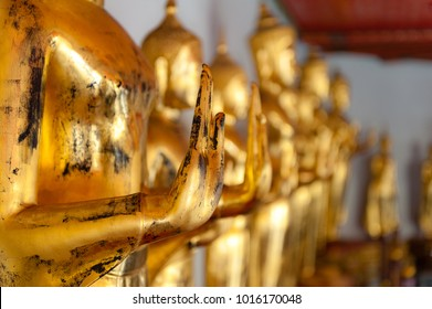 Detail of golden Buddhas displayed at Wat Pho, Bangkok, Thailand. Wat Pho, is a Buddhist temple complex in Bangkok, Thailand. It houses the largest collection of Buddha images in Thailand.
