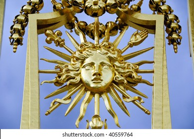 The detail from the golden gate at Versailles palace, near Paris France, represents, Louis XIV, the Sun King.