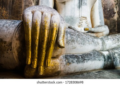 Detail of the golden hand of Phra Achana, an old large historic Buddha statue at Wat Si Chum in Sukhothai, Thailand