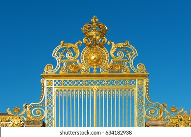 Detail of the golden Versailles palace gate entrance, France.