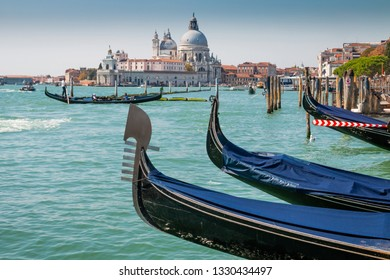Detail of gondolas with basilica saint Maria in background