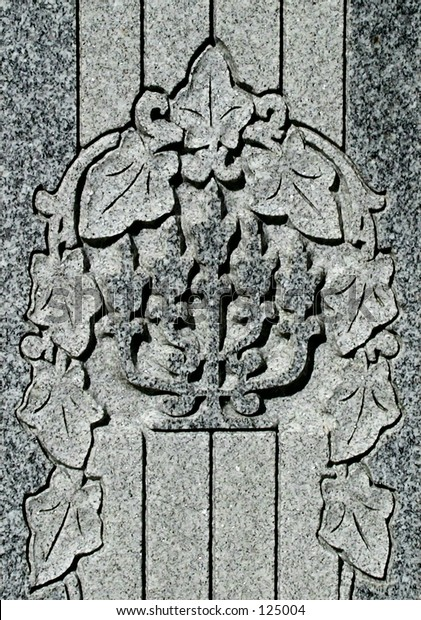 detail from gravestone in Jewish cemetary, showing a menorah