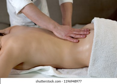 detail of greasy oil hands, which perform an ayurveda massage on the back