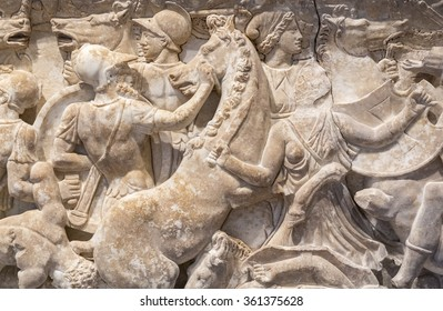 Detail of Greek carvings representing a great battle registered on a marble wall.