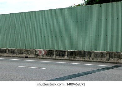 Detail of green noise barrier near the road