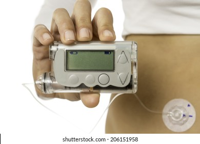 detail of a hand holding an insulin pump isolated on a white background - focus on insulin pump