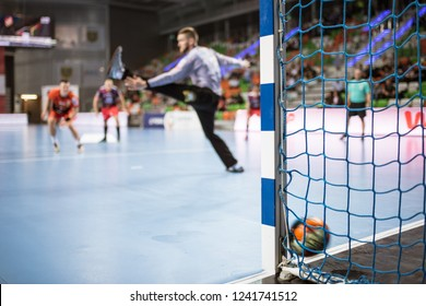 Detail of handball goal post with net and ball carrying to the goal