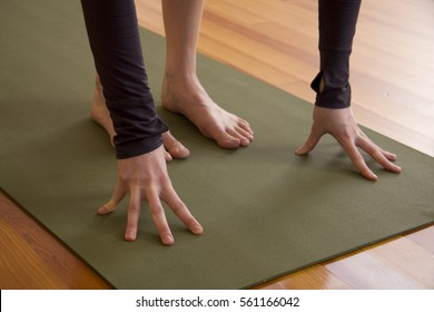 Detail of Hands and Feet on a Yoga Mat. Closeup in the studio of a class. Teacher or student practicing meditation.