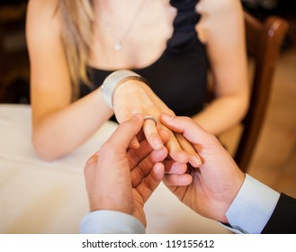 Detail of hands in a restaurant