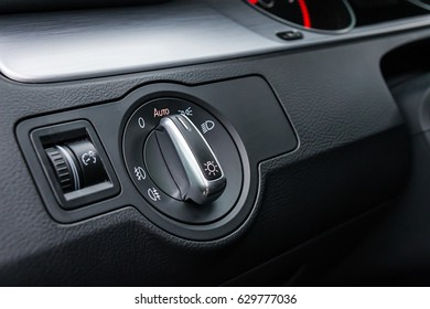 Detail Of The Headlight Button In Car Dashboard