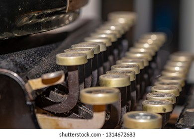 Detail of a historic dusty portable typewriter made in Germany during the twenties of the 20th century.