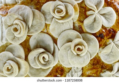 Detail of Homemade decorated Serbian slava bread. flowers from the dough.
