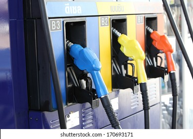 Detail of hoses of petrol pump at a gas station, selective focus