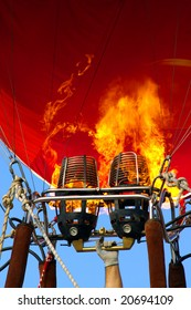Detail of hot air balloon with bright burning flame
