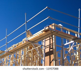 Detail of a house frame under construction with safety scaffolding