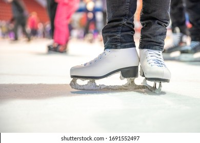 Detail of ice skating while skating on ice rink