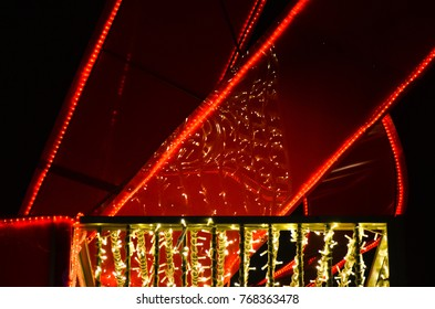 detail of illuminated gift box Christmas street decoration at night