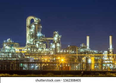 Detail of illuminated petrochemical industry in darkness on Maasvlakte area port of Rotterdam, the Netherlands