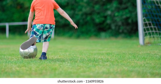 Detail image of a toddler playing soccer