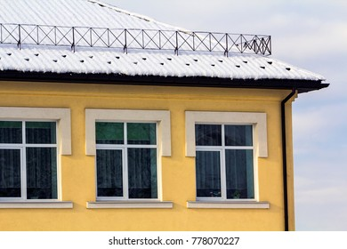 Detail image of a yellow building with windows