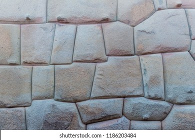 Detail of Inca's perfect stonework. Wall of former palace of Inca Roca in Cuzco, Peru.