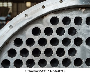 Detail of industrial heat exchanger, a shell and tube condenser, made from stainless steel.
