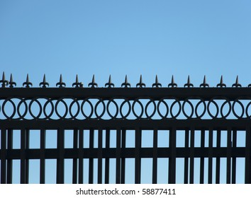 Detail of iron fence against the sky