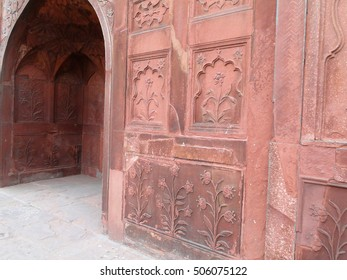 Detail, Islamic bas relief decoration on red sandstone of entry gate,  Lal Qila or Red Fort in Delhi,  India