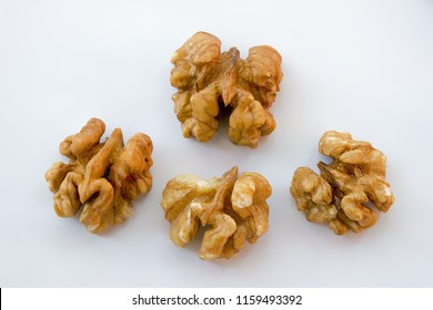 Detail of isolated four walnuts on a white background with free space for text