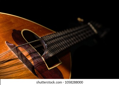 Detail of a Italian mandolin with black background.