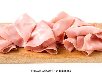 Detail of Italian mortadella on cutting board, on a white background