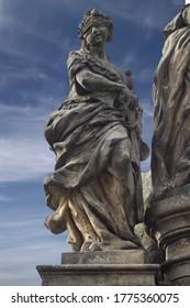 Detail of Ivo of Kermartin sculpture at Charles Bridge in Prague, Czech Republic. It is a 1908 copy of original Matthias Braun sculpture from 1711.